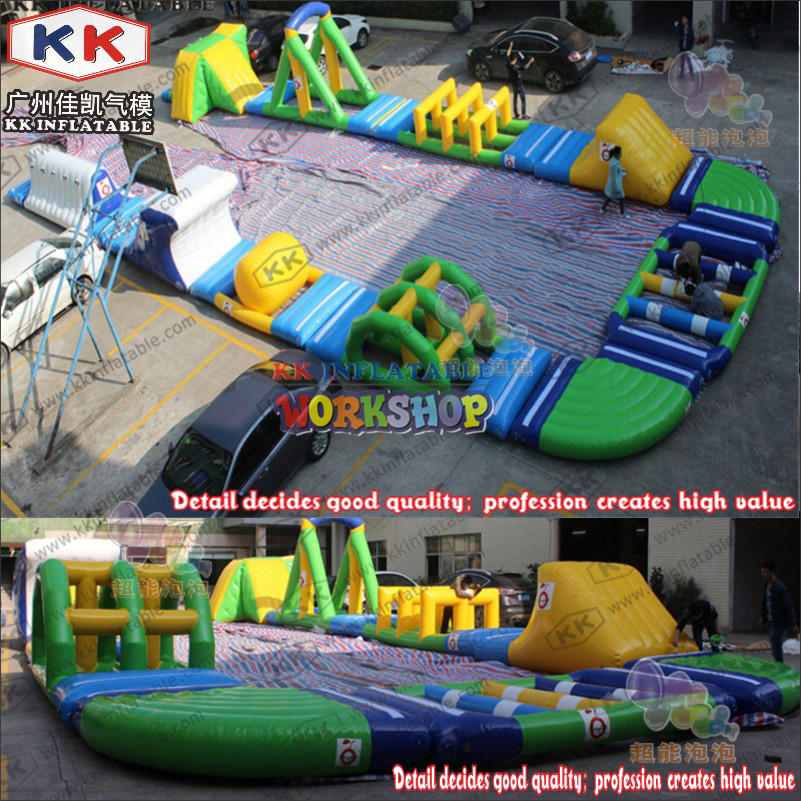 Water flushing inflatable floating park