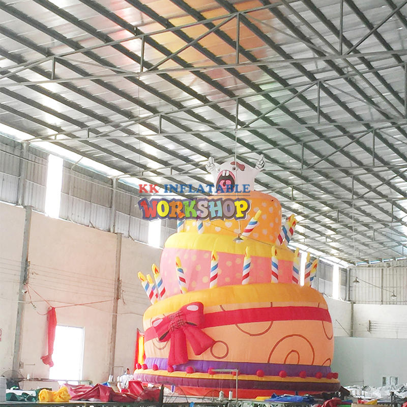giant inflatable birthday cake with candles